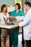 Medical team talking with patients. Medical team talking with a patient in the doctors office Royalty Free Stock Image