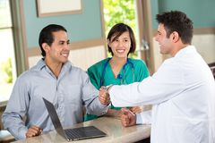 Medical team talking with patients. Stock Photography