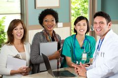 Medical team talking with patients. Medical team talking with a patient in the doctors office Royalty Free Stock Photography