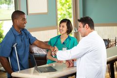 Medical team talking with patients. Medical team talking with a patient in the doctors office Stock Photography