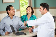 Medical team talking with patients. Royalty Free Stock Photography