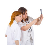 Medical team of two study an x-ray Stock Image