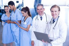 Medical team using laptop and digital tablet Royalty Free Stock Photography