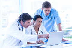 Medical team using laptop Royalty Free Stock Images
