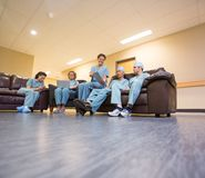 Medical Team Using Technologies In Hospital's Stock Photos