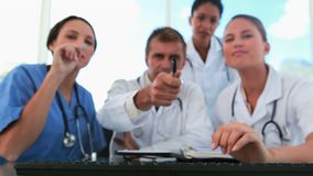 Medical team watching a computer screen Royalty Free Stock Photos