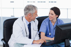 Medical team working with a computer Stock Photography