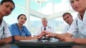 Medical team working with a computer together Stock Image