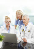 Medical team working with laptop Royalty Free Stock Image