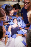 Medical Team Working On Patient In Emergency Room Royalty Free Stock Image