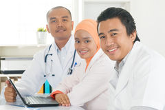 Medical team working together at hospital office. Royalty Free Stock Photos