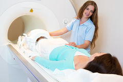 Medical technical assistant preparing scan of knee with MRI Stock Photography