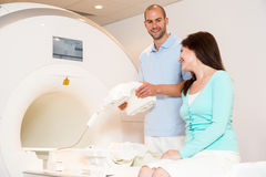Medical technical assistant preparing scan of knee with MRI Stock Images