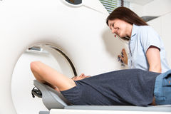 Medical technical assistant preparing scan of the spine with CT Stock Photo