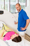 Medical technical assistant preparing scan of the spine with CT Royalty Free Stock Photo