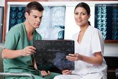 Medical Technicians Analyzing MRI X-ray royalty free stock photos