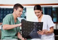 Medical Technicians Reviewing MRI X-ray Royalty Free Stock Images