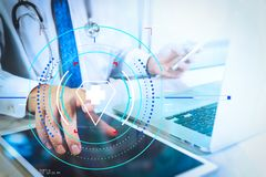 Medical technology concept. Doctor hand working with modern digital tablet and laptop computer with medical chart interface, Sun. Health care and medical royalty free stock images