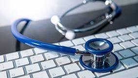 Medical technology. Stethoscope on white keyboard stock images