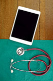 Medical Technology. Medical Technology with Tablet Computer and Stethoscope on operation cloth and wood background Stock Photography