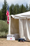 Medical Tent with American Flag. Medical tent entrance with a hand-made medical sign and an American Flag.  Runners aid station, as indicated by the shoes Royalty Free Stock Image