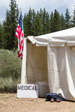 Medical Tent with American Flag. Medical tent entrance with a hand-made medical sign and an American Flag.  Runners aid station, as indicated by the shoes Stock Photo