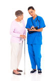 Medical test result. Nurse explaining medical test result to senior patient royalty free stock image