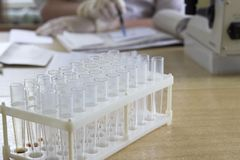 Medical test tubes close-up, microscope, hands, percussion stock photos