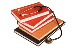Medical text books. Stethoscope on a stack of reference books isolated on white Royalty Free Stock Image