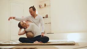 Medical thai massage - caucasian model female - stretch the muscles and spine Stock Photography