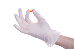 Medical Theme. Right hand holds a red pill Stock Images