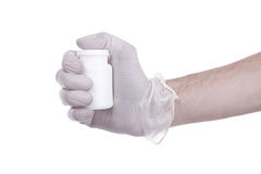 Medical Theme. Right hand shaking a white packaging for tablets stock photography