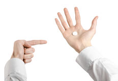 Medical theme: doctor's hand holding a white tablet for health on a white background isolated Royalty Free Stock Photos
