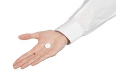 Medical theme: doctor's hand holding a white tablet for health on a white background isolated Royalty Free Stock Images
