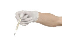 Medical theme: doctor's hand in white gloves holding a thermometer to measure the temperature of the patient on a white background Royalty Free Stock Photography