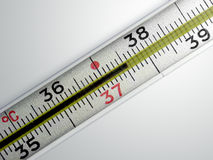 Medical thermometer. With with temperature 37.5 on a gradient background Royalty Free Stock Image