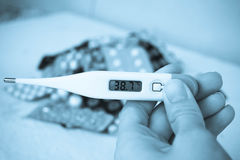 medical thermometer and medicines in tablets Royalty Free Stock Photos