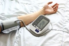 Medical tonometer for measuring blood pressure of male patient stock photos