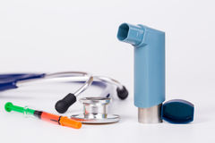 Medical tool. Stethoscope,syring  and asthma inhaler on white background Stock Photo
