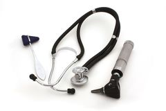 Medical tools. Tendon hammer, stethoscope and otoscope - isolated over white Stock Image