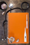 Medical tools and notebook Stock Photography