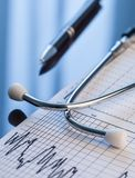 Medical tools. Stethoscope and cardiogram on a table. Stock Images