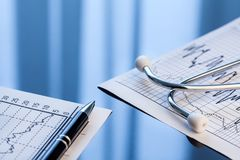 Medical tools. Stethoscope and cardiogram on a table. Stock Image