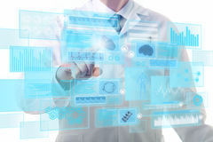 Medical touchscreen. Male doctor working on a futuristic touchscreen display Stock Image