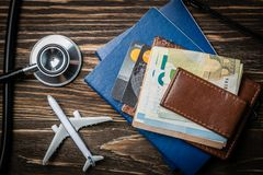 Medical tourism concept - passports, stethoscope, airplane, money. Top view royalty free stock images