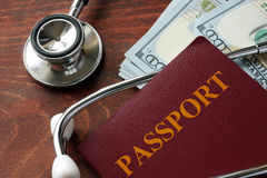 Medical tourism concept. Stethoscope with passport and dollar bills. Medical tourism concept stock photo