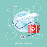 Medical Tourism. Icon of Traveling and Treatment. Flat design style modern concept of medical services abroad, along with the rest. Medical stethoscope around Royalty Free Stock Photo