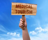Medical tourism wooden sign stock image