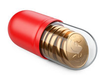 Medical transparent capsule with a golden coins. Stock Images