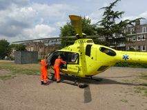 Medical trauma helicopter lands in Amsterdam. Rietland park, Amsterdam, the Netherlands -July 18 2018: emergency medical trauma helicopter lands in Amsterdam to royalty free stock photography
